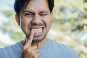 person pointing a tooth that hurts