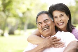 Smiling older couple with dental implants in Corpus Christi
