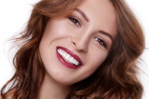 Woman with a beautiful smile from cosmetic dentist in Corpus Christi.