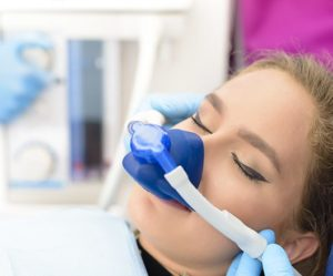 Woman using nitrous oxide at dentist